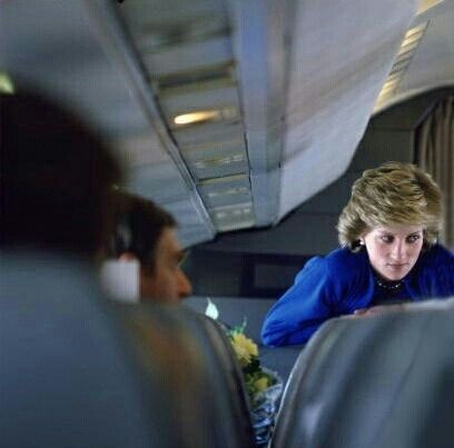 Diana on the plane home from Australia with Prince Charles.