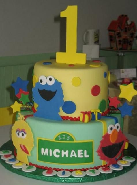 Two tier Sesame Street theme birthday cake for one year oldJPG