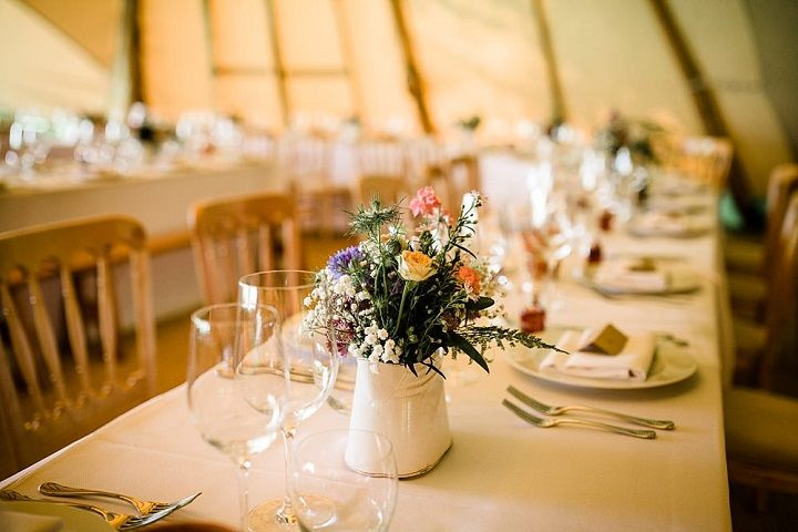 Unique wedding reception ideas on a budget – Jug wedding centerpices filled in with wild flowers