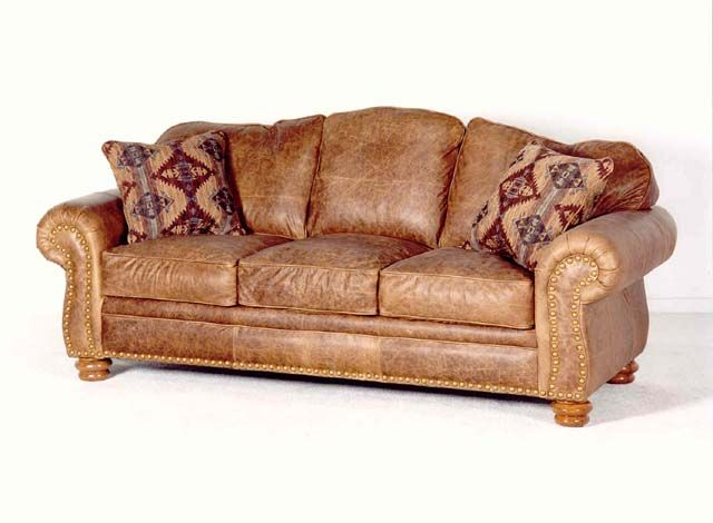 Love the distressed look....this is an interesting frame...not sure I love the rolled arm but like the leather...could do without the pillows..