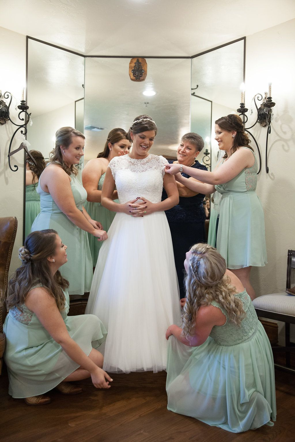 Bridesmaids Helping The Bride With Her Dress Bridesmaid Photo