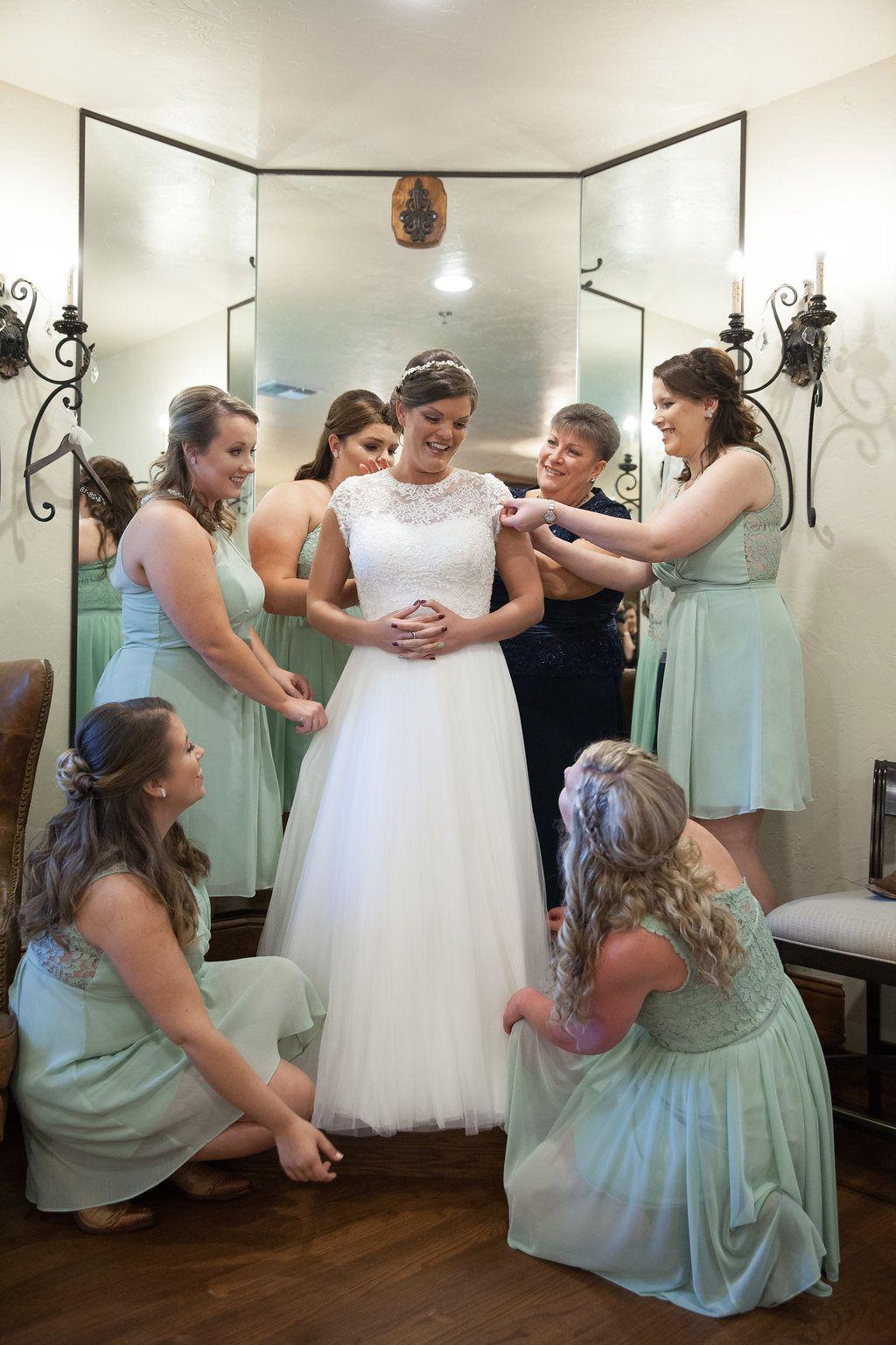 Wedding dresses tulsa  bridesmaids helping the bride with her dress  bridesmaid photo