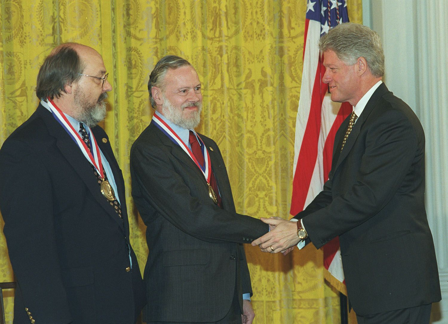 Left to right Kenneth L. Thompson, Dennis M. Ritchie and Bill Clinton.