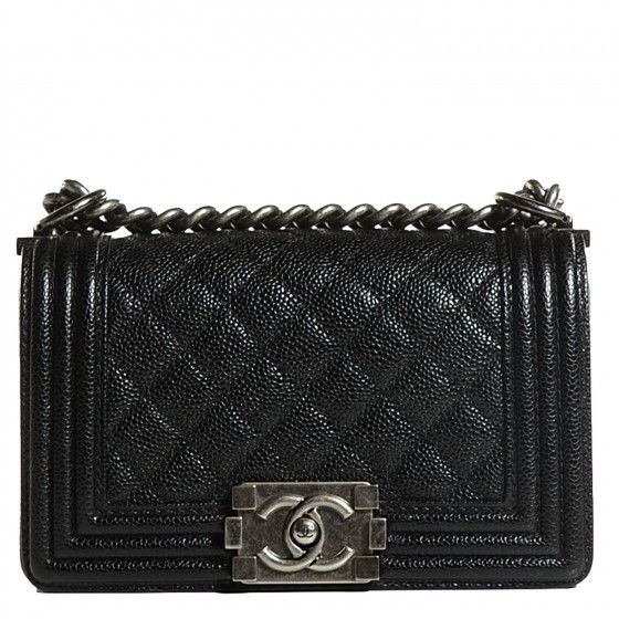 1e33909b8688 This is an authentic CHANEL Caviar Quilted Small Boy Flap in Black. This  popular shoulder