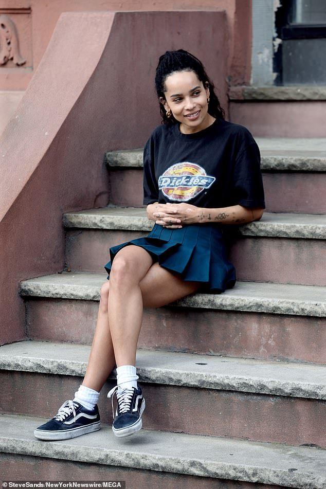 Zoe Kravitz rocks a short pleated skirt while filming High Fidelity