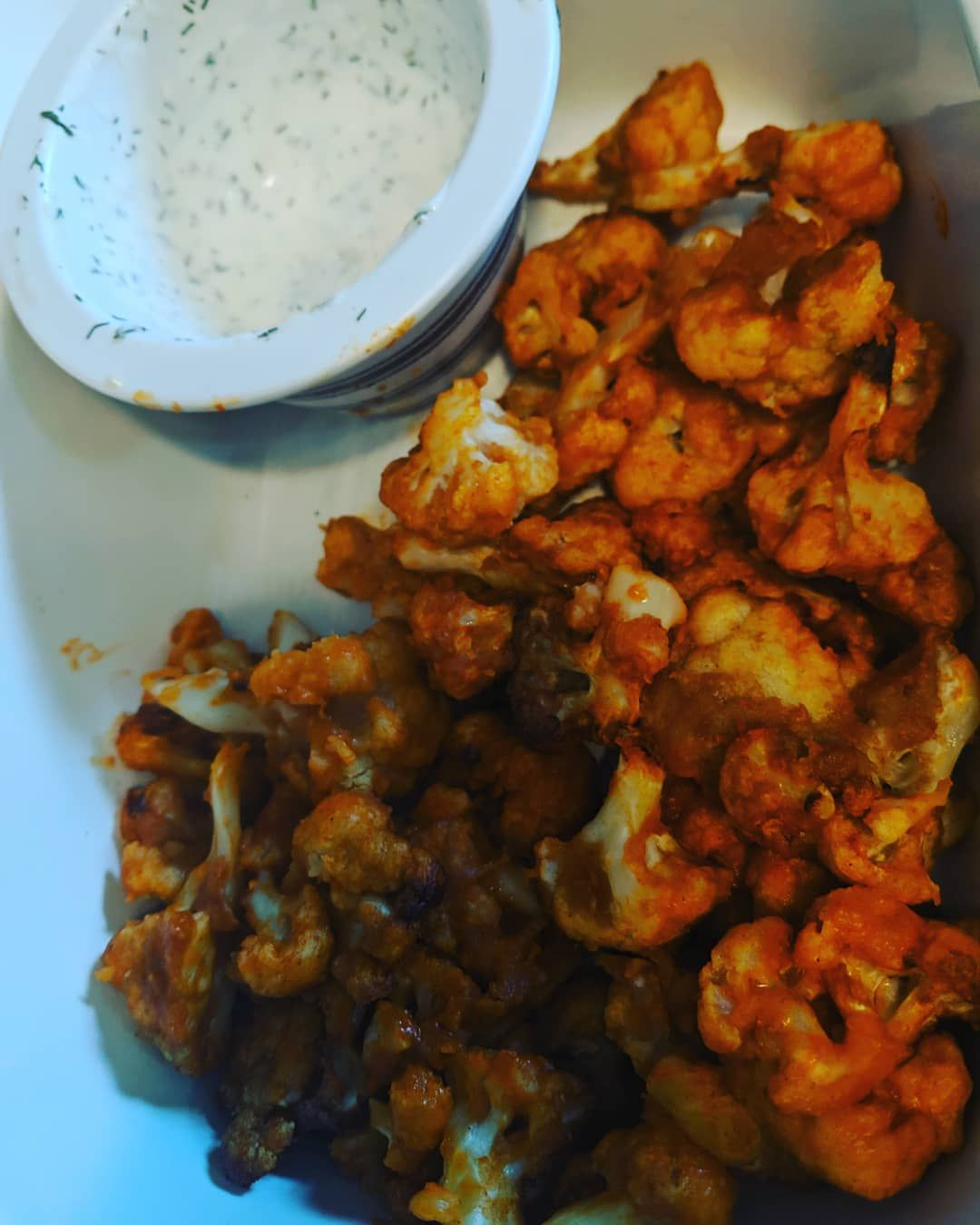 Air fried cauliflower wings with homemade ranch dipping sauce.  Easy and delicious appetizer for a BBQ today.