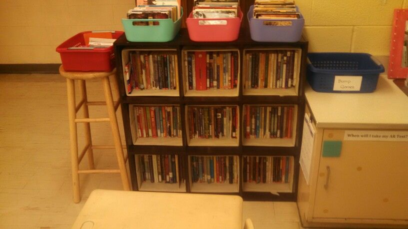 Books in smaller bins so they can take a box back to their seat and look through them. Red box full of magazines.