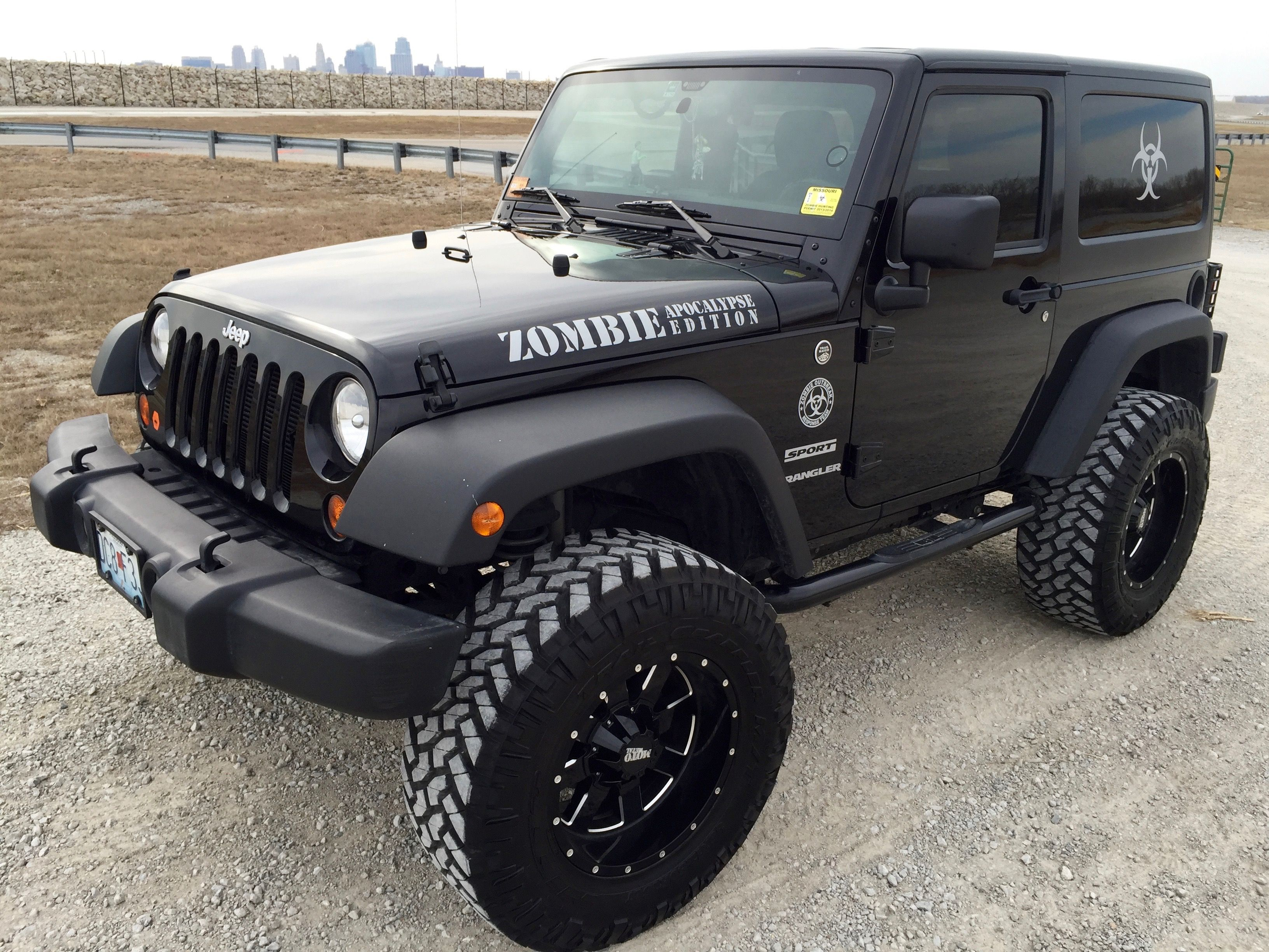 Zombie Apocalypse Jeep with hunting permits (window decals) and no