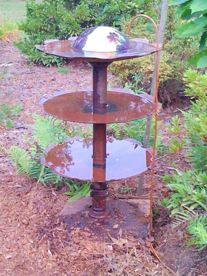 My Hubby Made Me The Neatest Bird Bath Out Of Old Plow Discs It Is Constantly Dripping Very Slowly I Absolutely Diy Yard Decor Bird Bath Recycled Garden Art