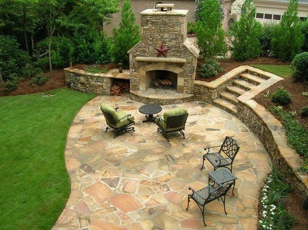 Small outdoor kitchen with flagstone walls and patio | fireplace and ...