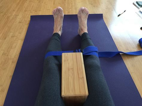 """""""place a yoga block between your knees and a yoga strap"""