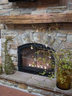 stone veneer mantel flanked by bookshelves - Google Search