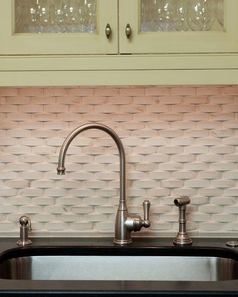 This backsplash by Danziger Design features 1x3 capri porcelain tile in a  crescendo brick pattern.