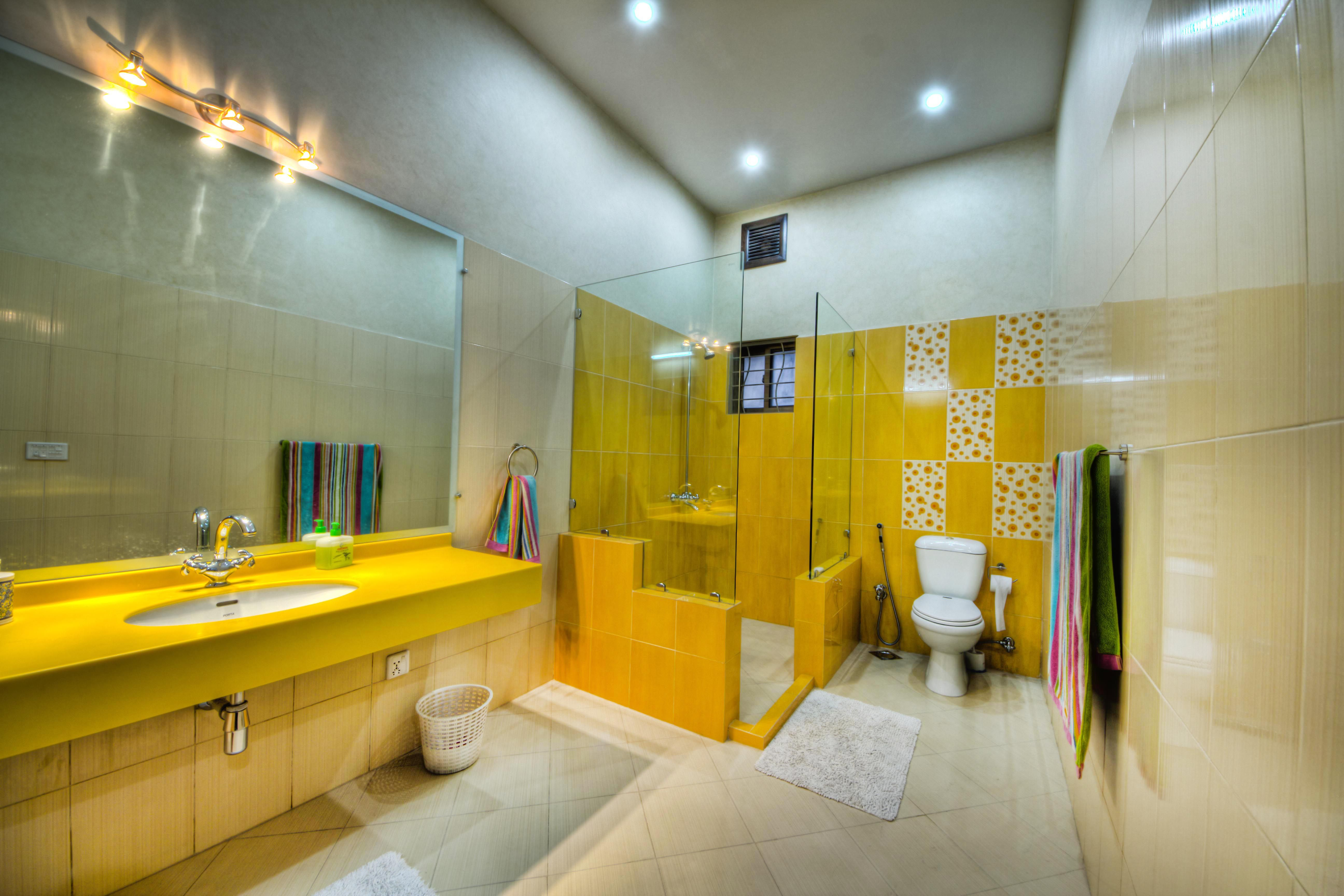 Bathroom Designed By Pakistan S Leading Architectural Design Firm Yellow Bathroom Decor Bathroom Decor Yellow Bathroom Walls
