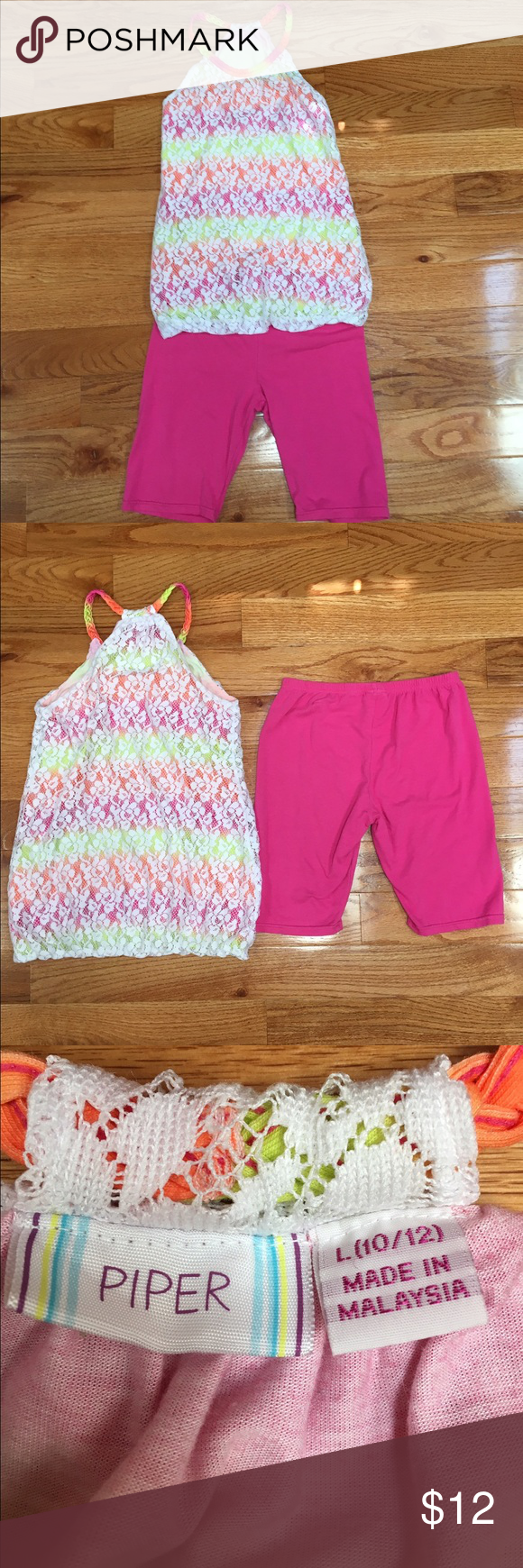 Cute Summer Outfit In this summer outfit there is comfortable pink shorts and a tank top that has a necklace shape. The shirt has pink,green, & orange inside of it and a white lace over it. Awesome outfit ! The size is 10/12. Been worn but gently used. Shirts & Tops Tank Tops