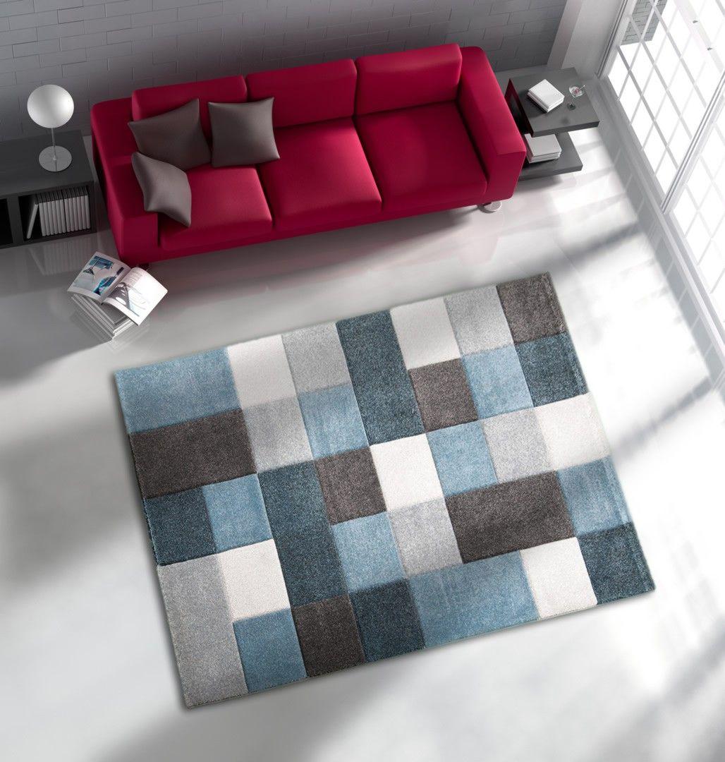 le tapis bleu eden dot de plusieurs carrs design comme motifs dintrieur est un tapis original alliant esthtique et charme idal pour le salon - Tapis De Salon Bleu