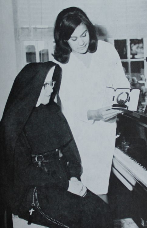 Kiri Te Kanawa showing her singing teacher Dame Sister Mary Leo her Melbourne Sun Aria award. 1965. #TBT