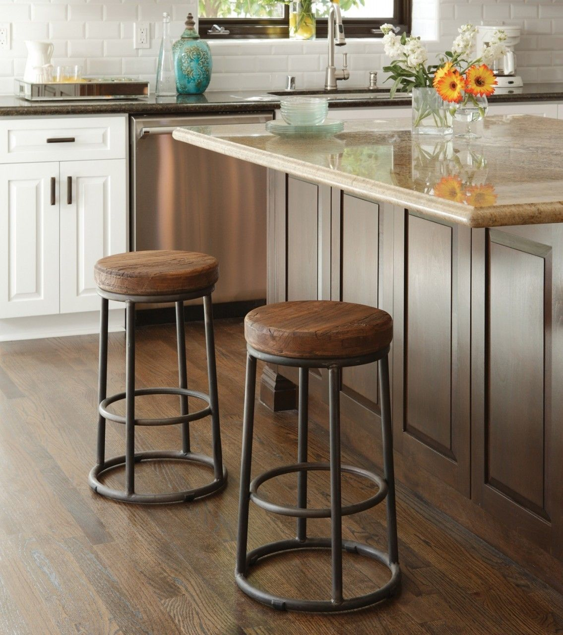 This modern take on an old classic barstool creates a show piece in any home with its reclaimed pine wood seat and it's sturdy iron base construction. Handcrafted of Salvaged wood and recycled iron Ro