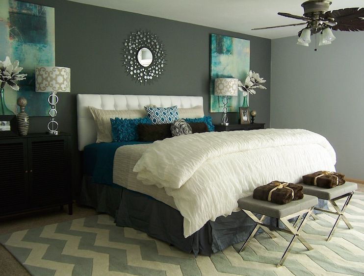 A Modern Teal And Gray Bedroom Featuring A White Upholstered