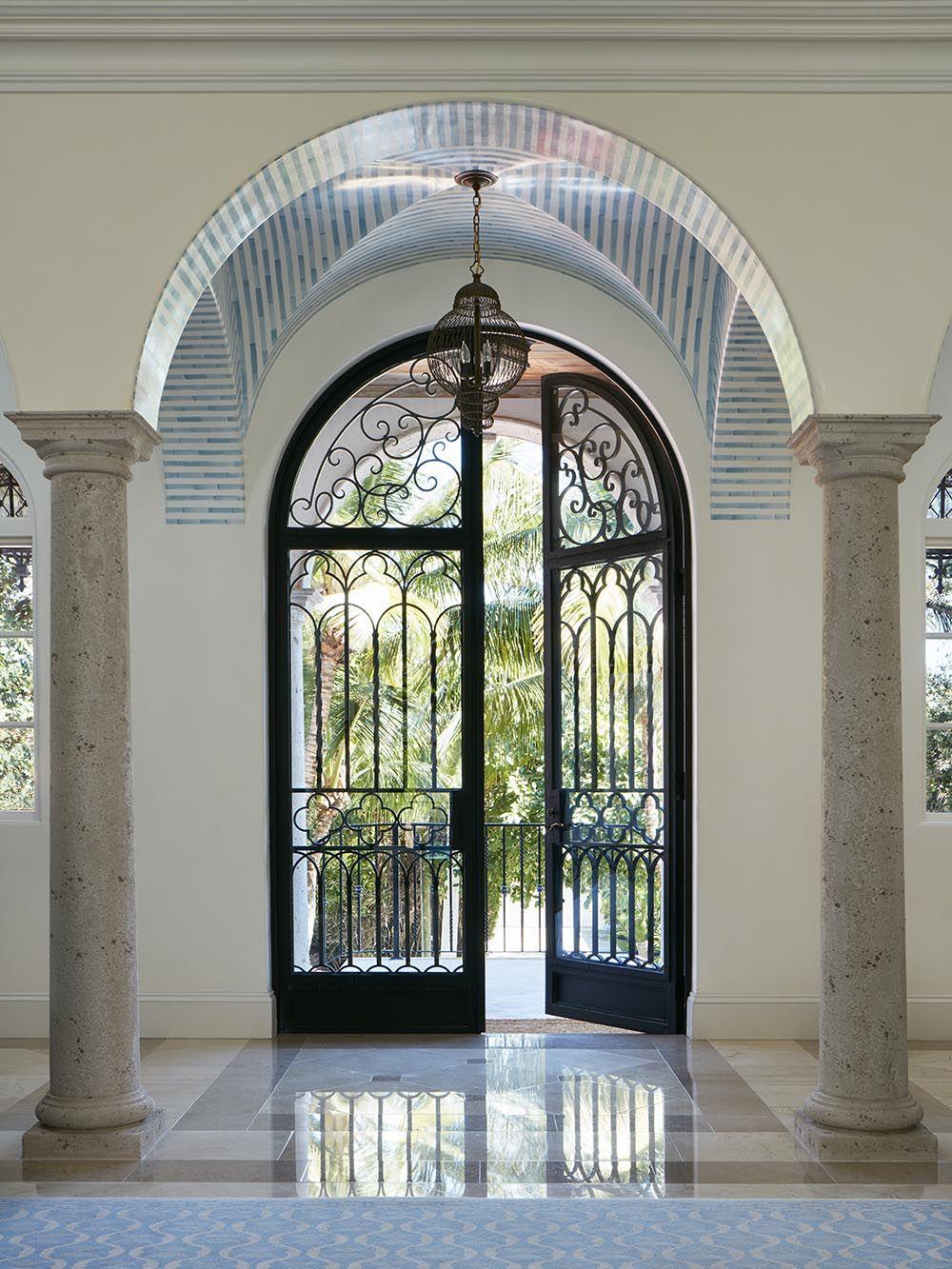 Doors Design: Grand Arched Double Front Door With Delicate Steel Work