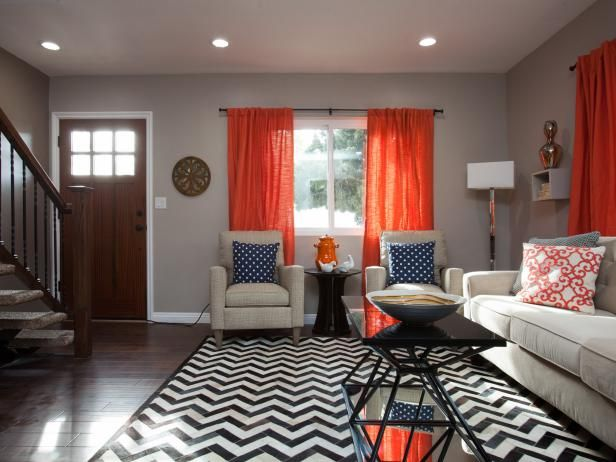 taupe living room with orange curtains and chevron rug home ideas