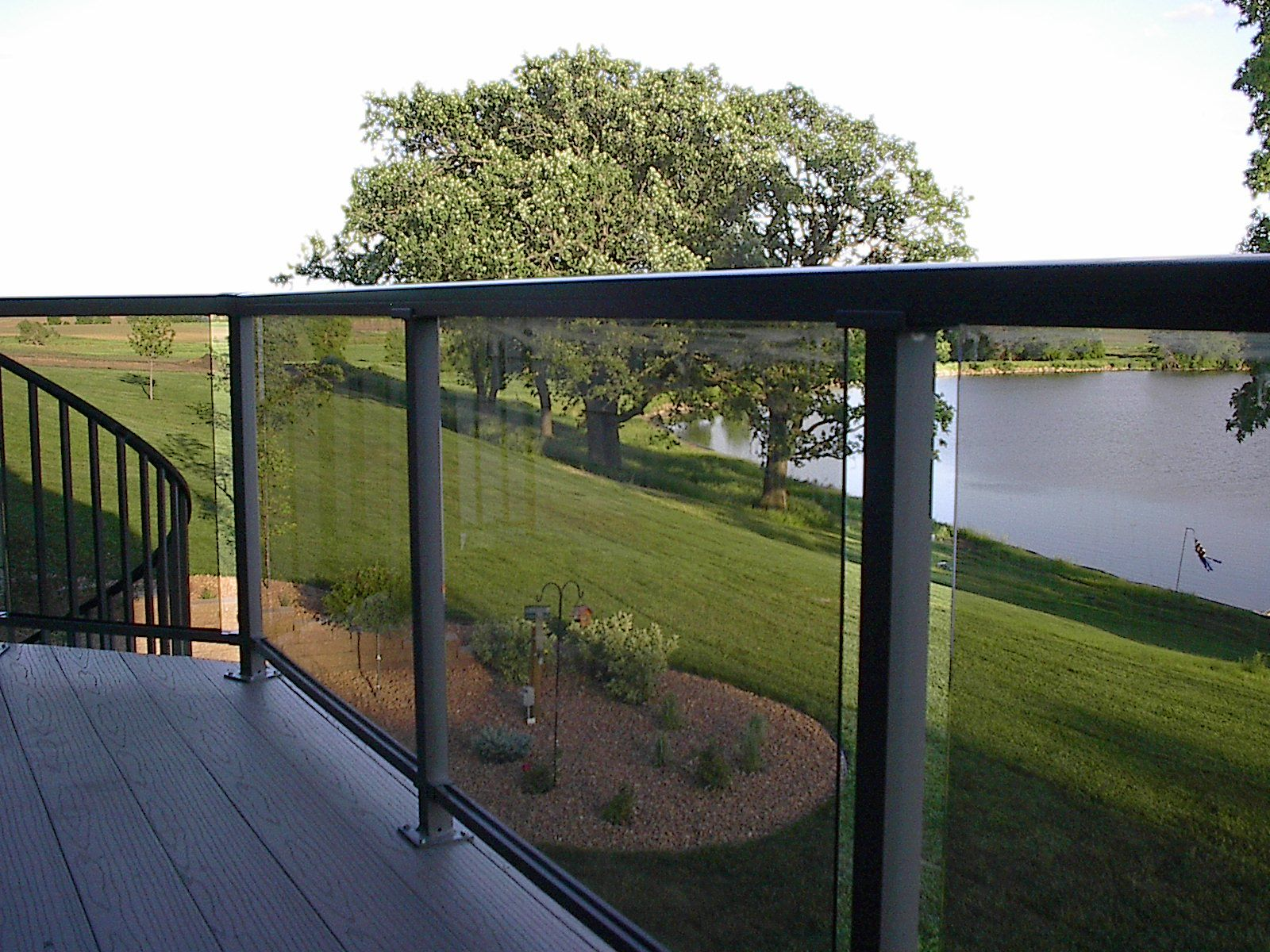 Deck railing with glass panels see 100s of deck railing for Glass balcony railing