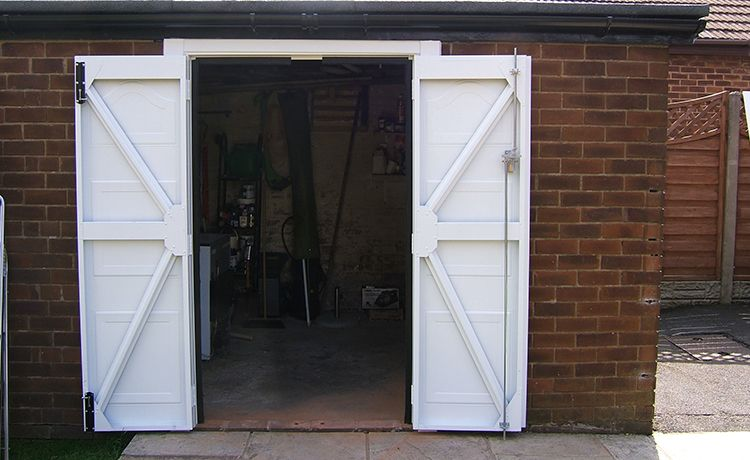 If You Are Looking For A Traditional Side Hinged Garage Door As Opposed To An Up And Over We Are Mo Side Hinged Garage Doors Garage Doors Carriage House Doors