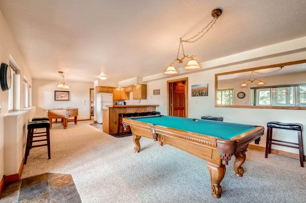 Game Room Featuring A Pool And Foosball Table Billiards Room