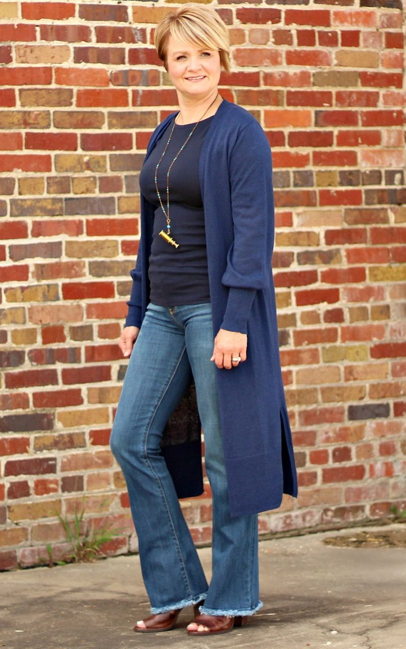 Fall casual outfit for women over long sweater and jeans