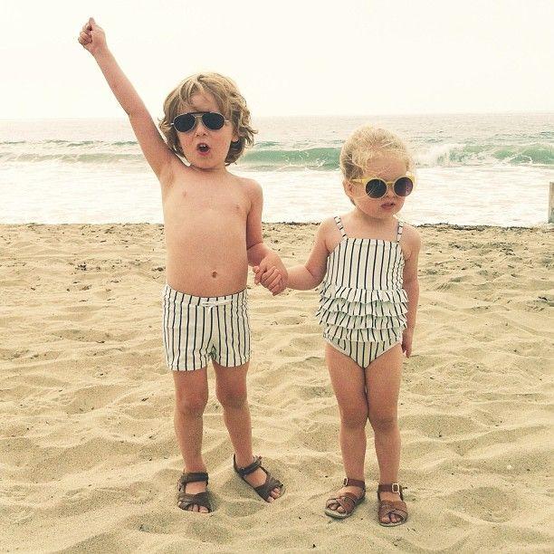88167d0ba3556 Vintage, nautical inspired matching boy girl kids swimsuits. Mini Rodini  Striped ruffle swimsuit and swim shorts. Photo from @thesestylishkids on  instagram.