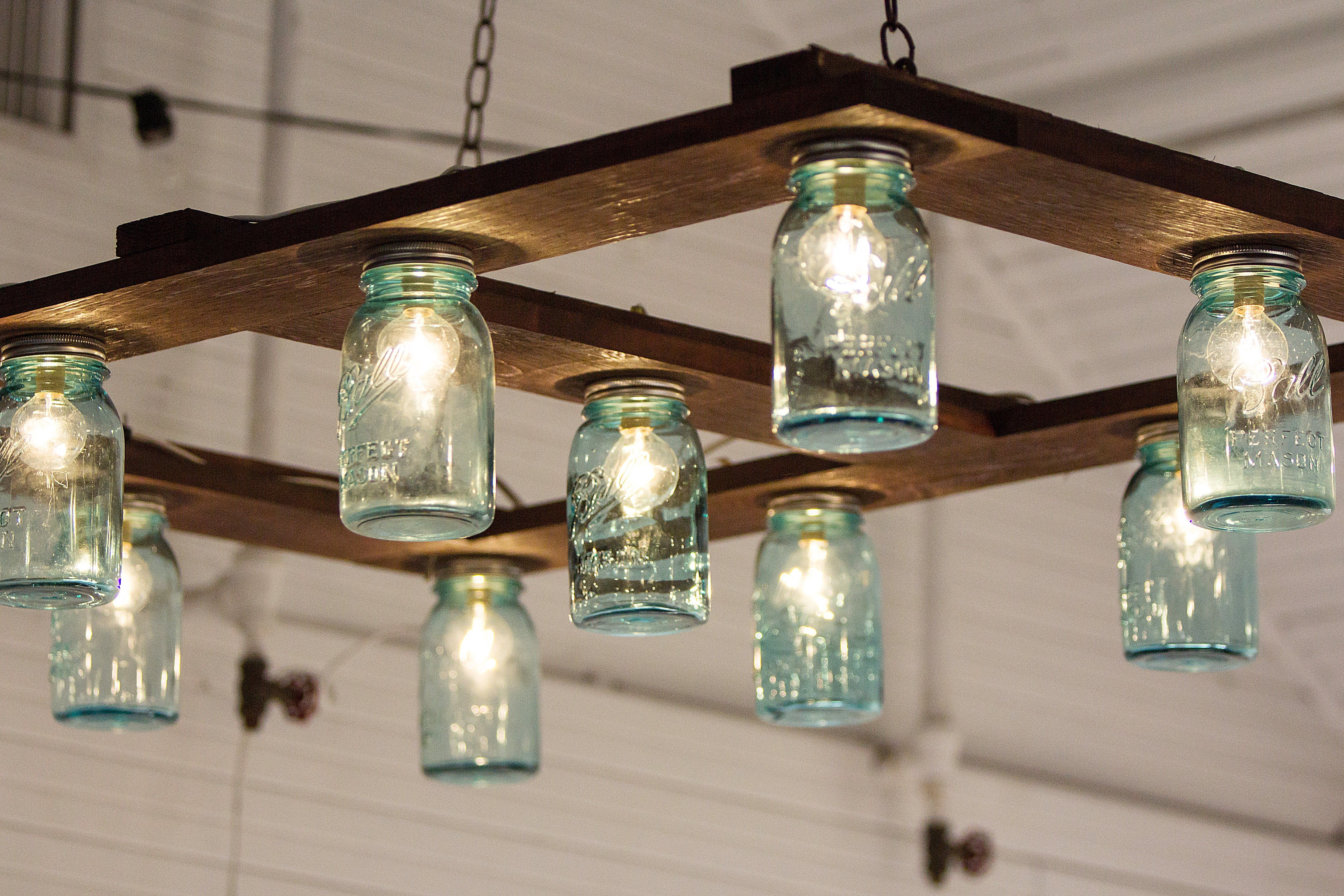 Hanging Mason Jar Light Out Of Mason Jars Cafe Lights And A Wood