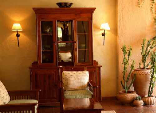 An African living room, with plaster walls, iron wall sconces