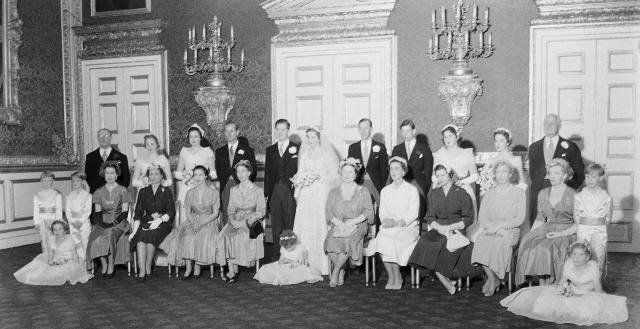 Wedding of John Spencer and Frances Roche, parents of Princess Diana. Family photo - Sitting to bride's right, Queen Mother Elizabeth, Lady Ruth Fermoy. Sitting to grooms left, Queen Elizabeth, Princess Margaret.