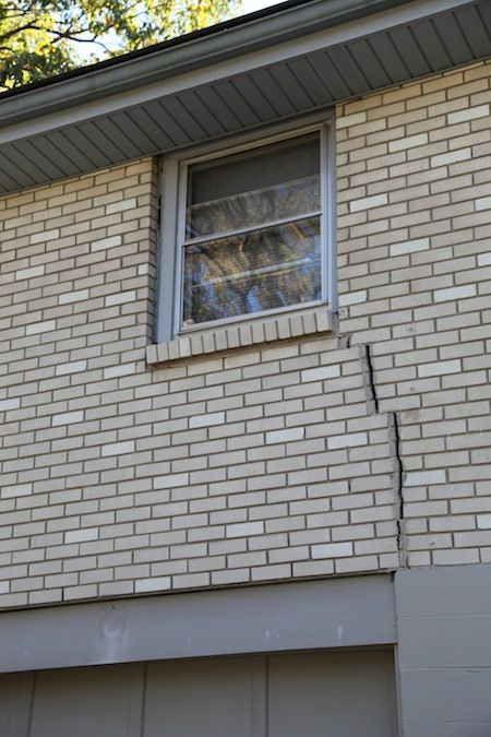 vertical cracks can be a sign of foundation settlement on types of walls in homes id=93127