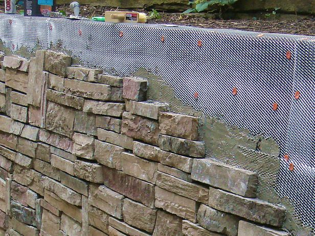 How To Cover A Stone Wall Railroad Tie Retaining Wall Diy Stone