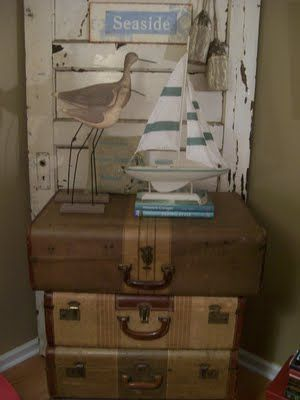 could use suitcases as base for tree & ship w/art piece that says I'm here but my heart is at the beach