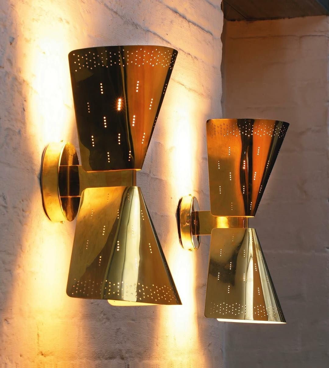 Brass sconces designed by Paavo Tynell for Taito Oy of Finland in the 1950's. Photo: Sothebys #mcmdaily #paavotynell #taitooy #finland mcmdaily.com