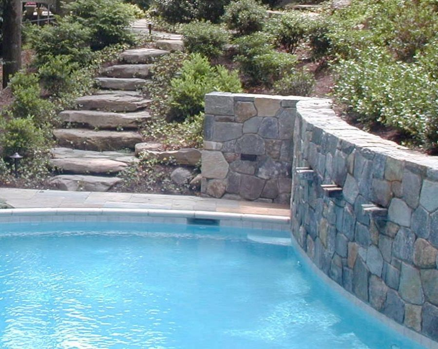 Hillside landscaping with pool hillside pool in for Pool design retaining wall