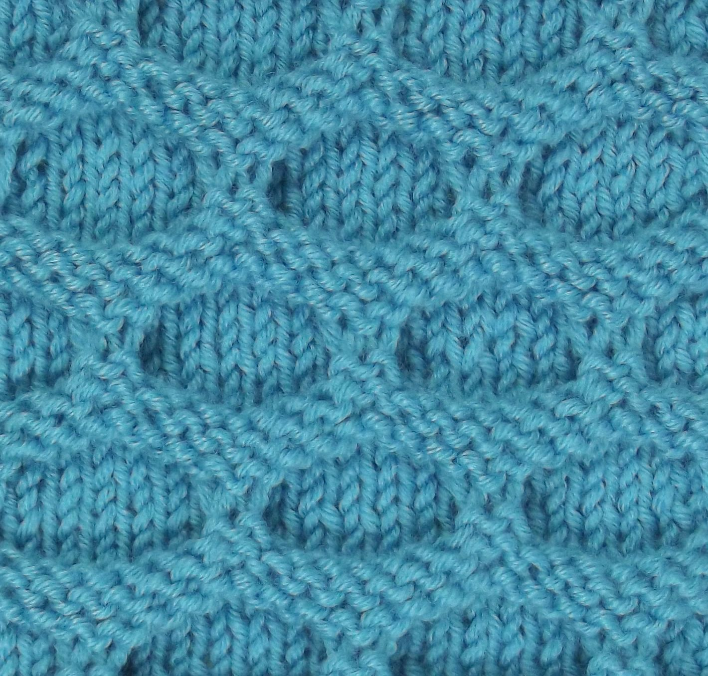 The Paving Stitch can be found in the Bobbles & Slip Stitches category. This simple slip stitch pattern results in a deeply textured fabric.