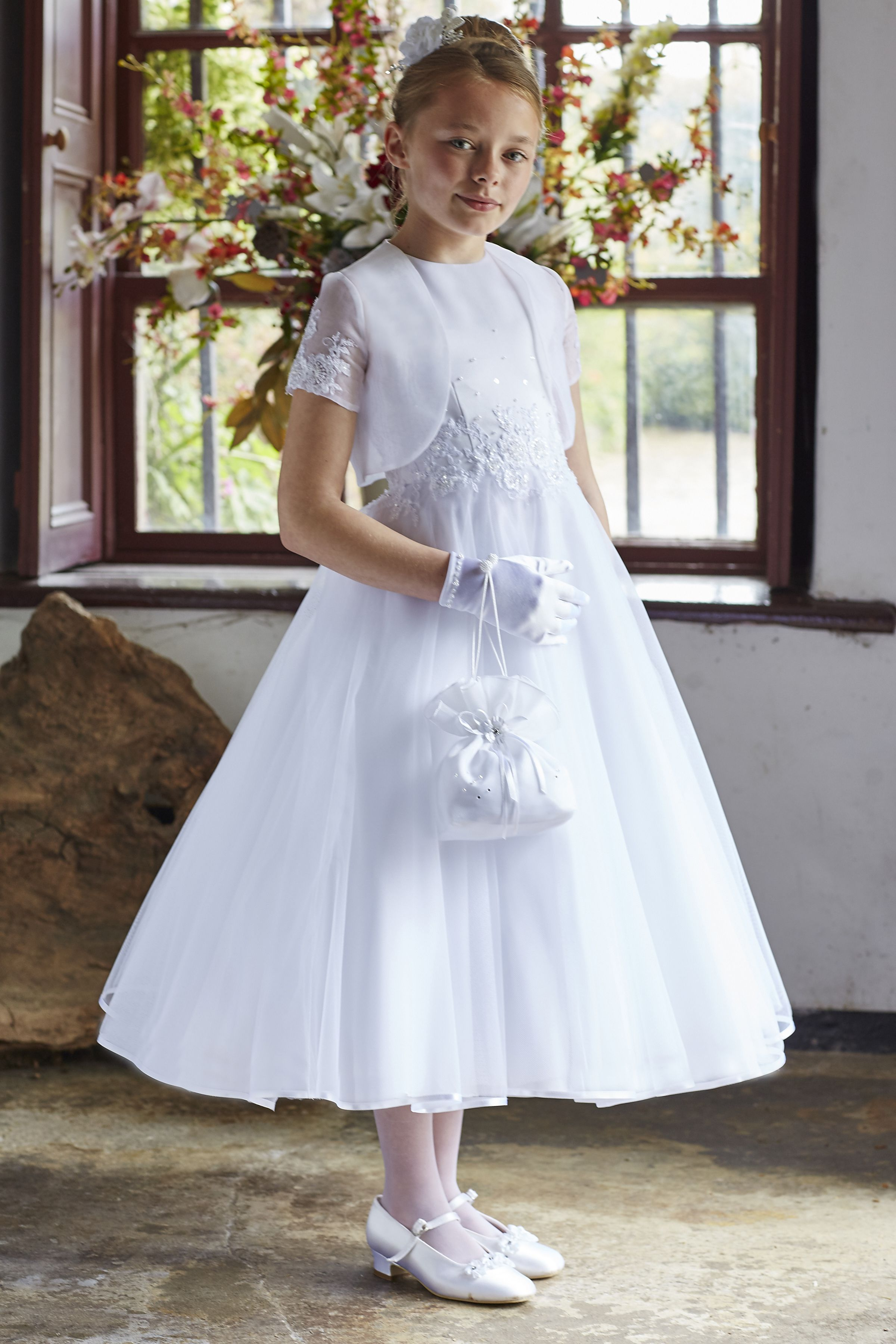 Lace tulle communion dress with matching jacket.