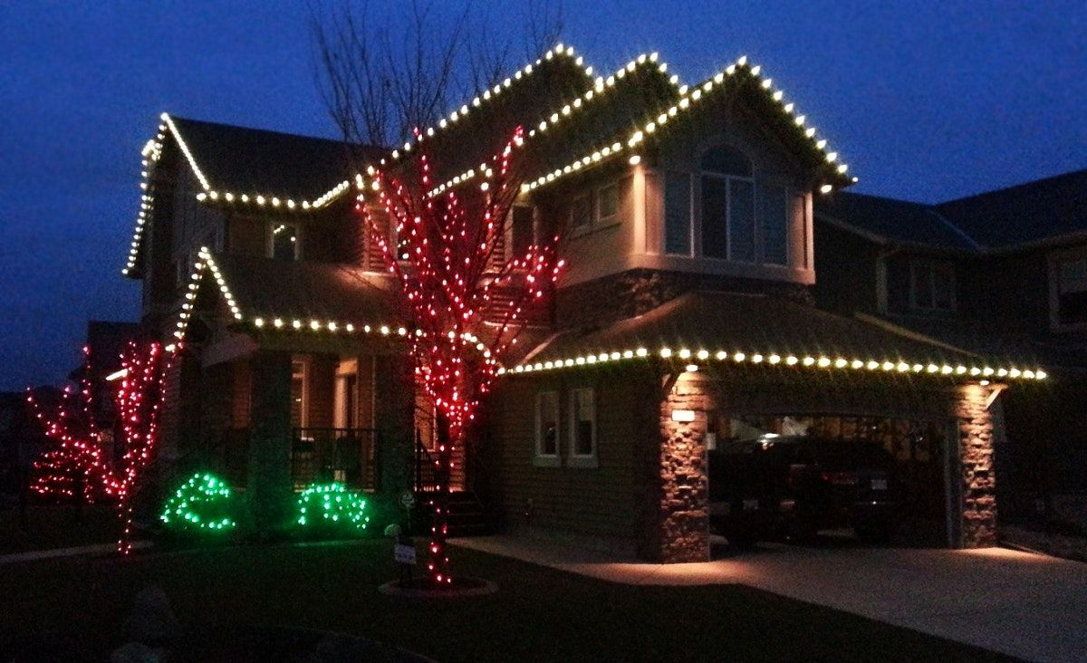Captivating Christmas Light Hanging Service Red White And Green Lights On Modern Home  Decoration 4 Richards.