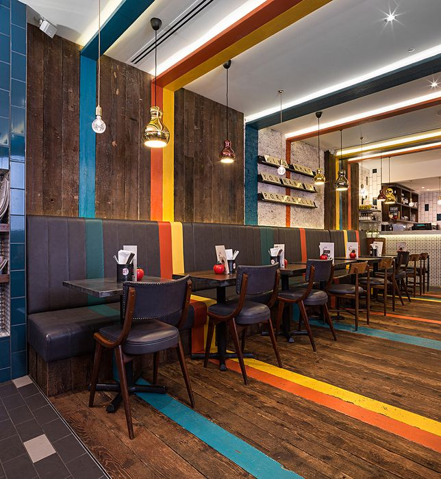 Burger Kitchen: Mixing Bright Colors With Wood Floor Paneling Along The