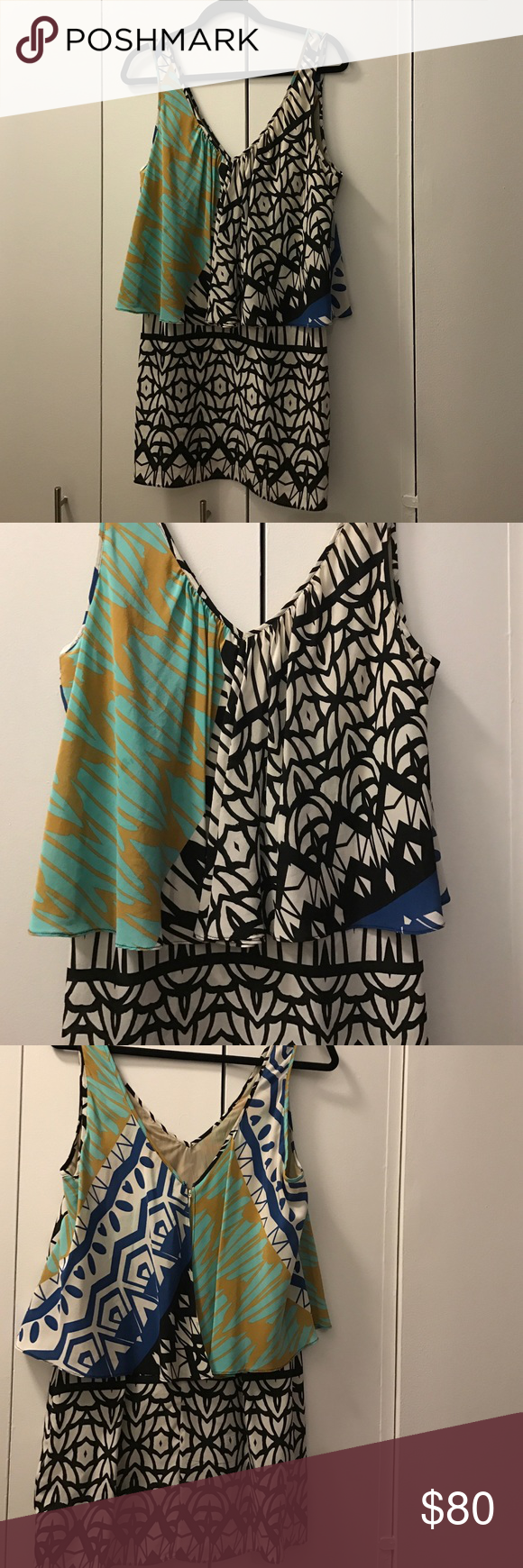 Printed spring dress. Good quality fabric, almost new condition. Has a little stretch to the fabric with lining in the top. Zipper on the back with another layer for the top. Can look like a two piece dress. Doesn't show size but fits like a small Plenty by Tracy Reese Dresses
