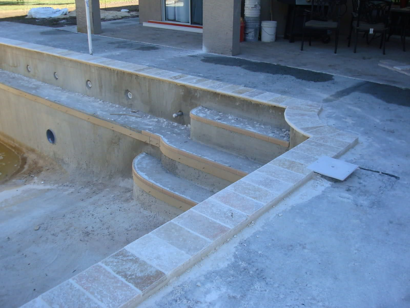 Silver Travertine Pool coping with blue glass mosaics | One day ...