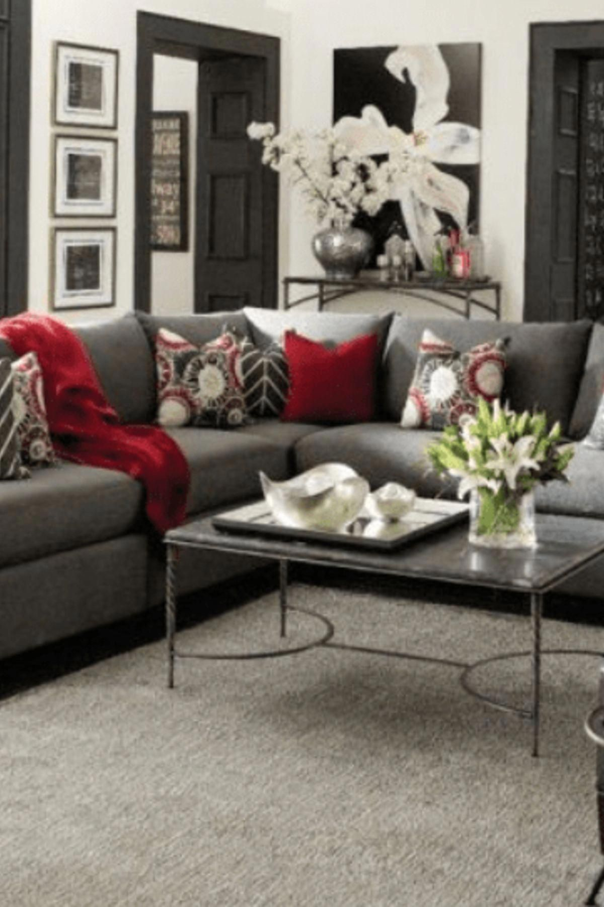 Home decor gray living room with red accent pillows light gray walls with dark
