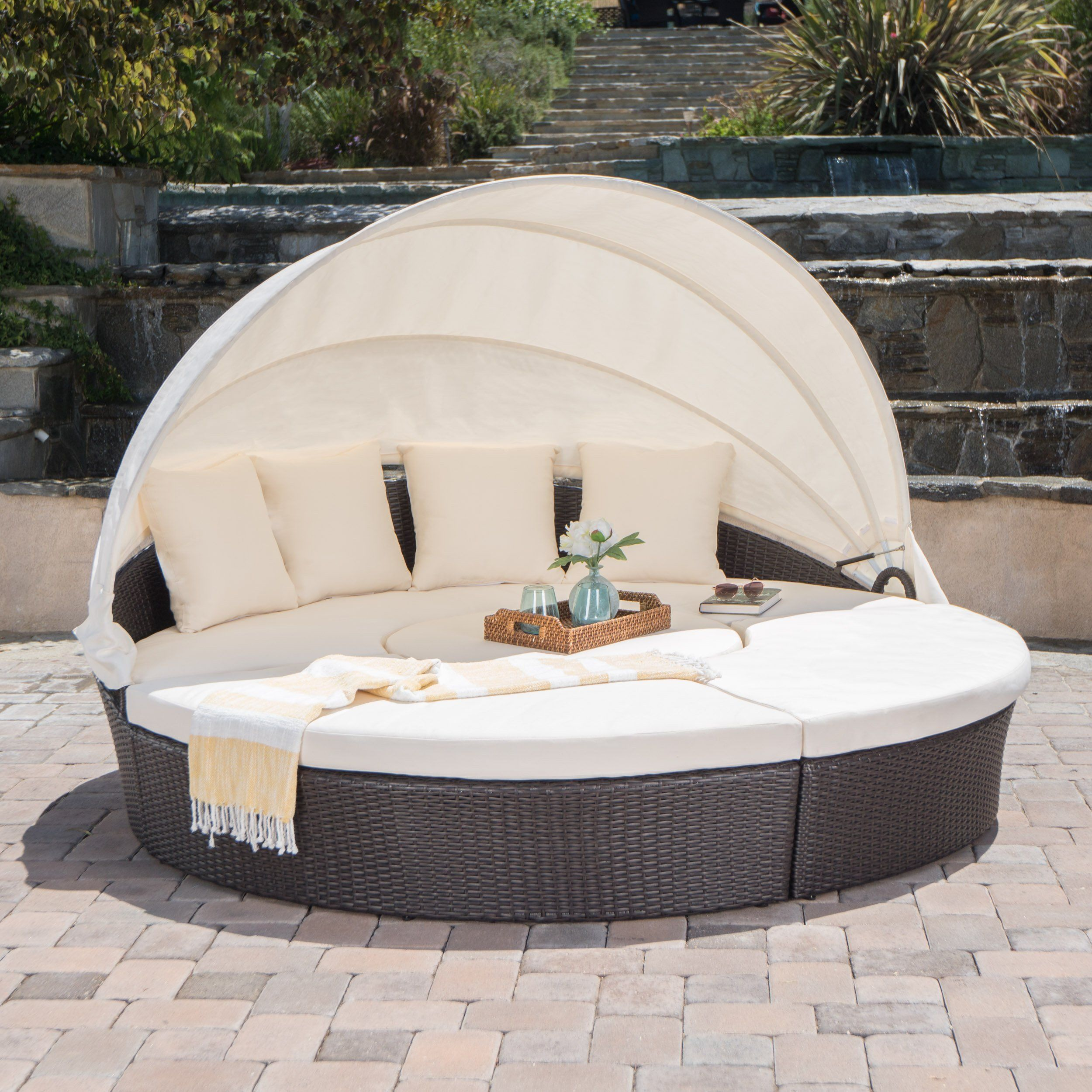 Bellagio outdoor brown wicker daybed with an aluminum frame and an ice bucket