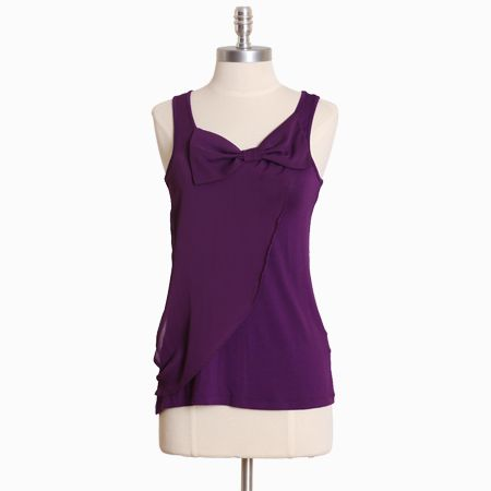 purple shirt with bow.