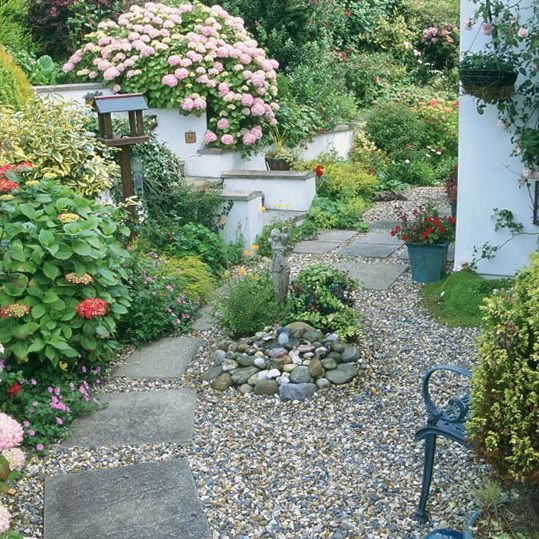 an easy design idea is to replace grass with gravel or coloured slate chips in your