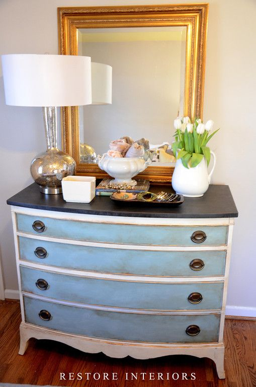 Painted blue and white dresser with a black or natural top dresser