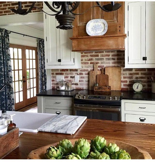 More Of The White Cabinets Black Countertop Brick Backsplash